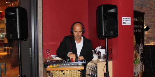 El Gran Inka Grand Opening DJ playing music.