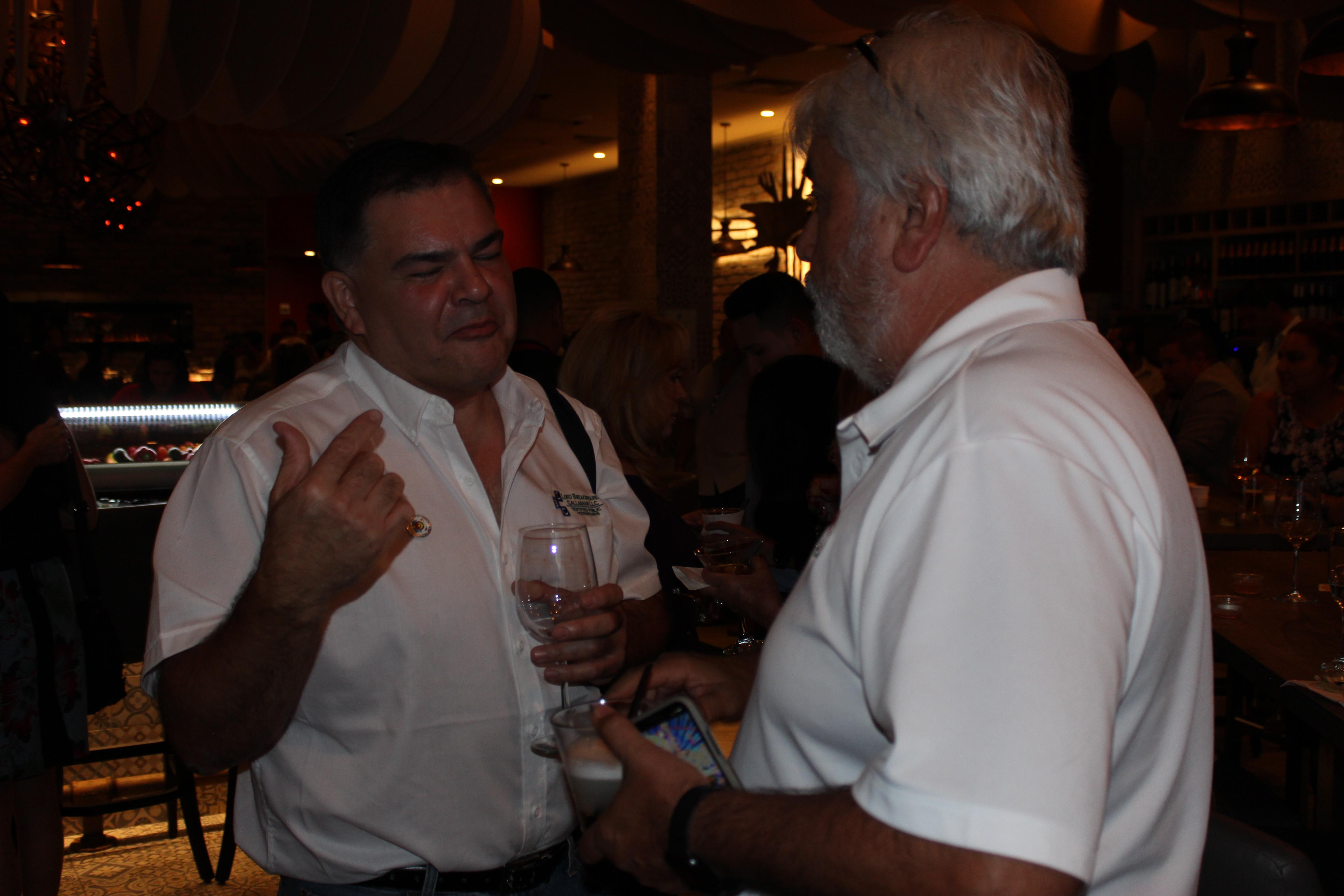 El Gran Inka Grand Opening people talking and having drinks.