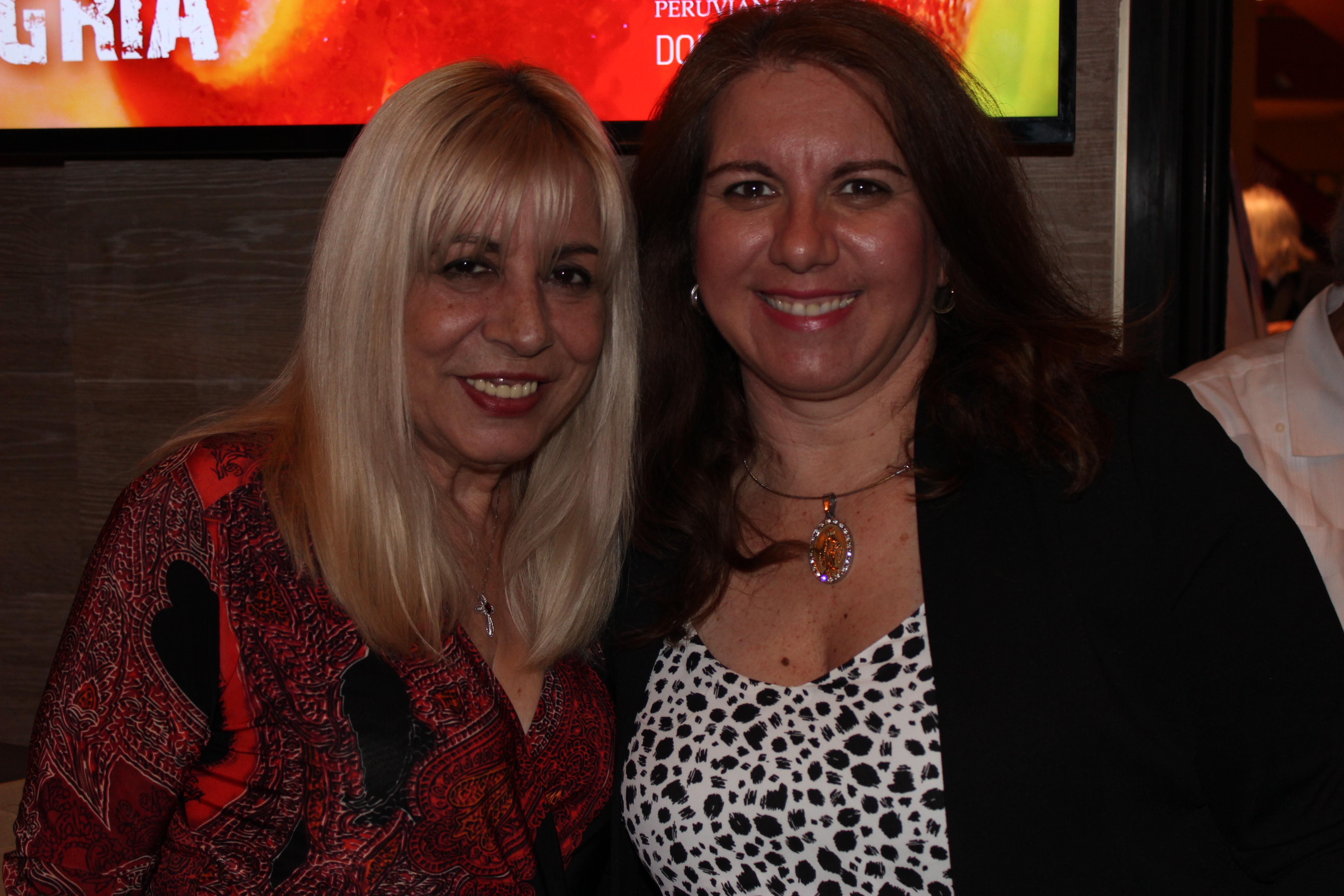 Carmen Lopez with a member in El Gran Inka Grand Opening.