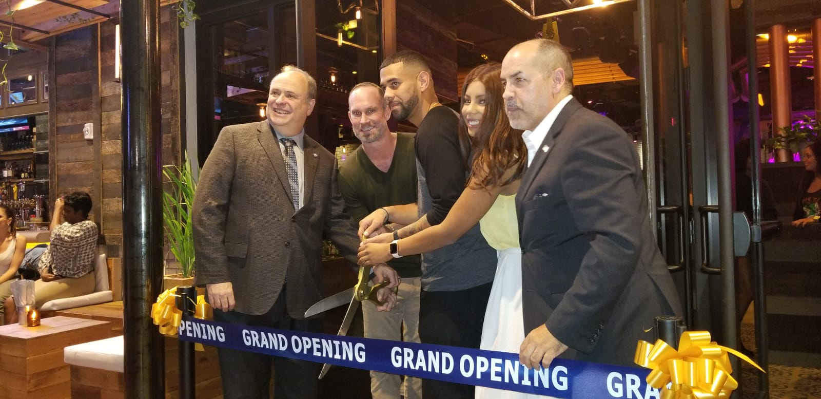 Ribbon Cutting with Mayor and Managers of Copper Blues Improv hosted by the Doral Chamber of Commerce.