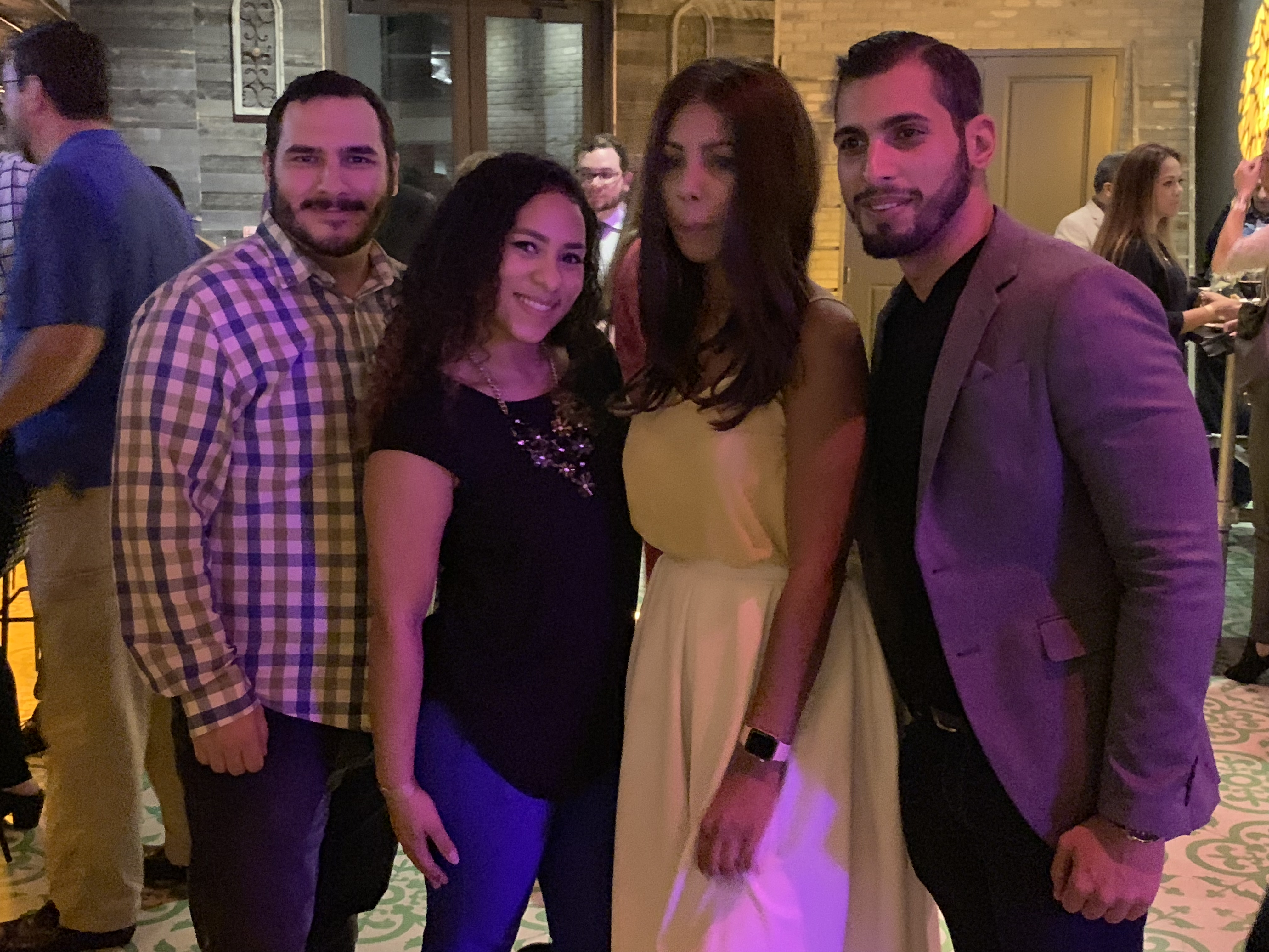 Group photo of couples in the Copper Blues Improv Grand Opening hosted by the Doral Chamber of Commerce.