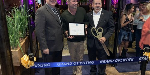 Ribbon cutting in Copper Blues Improv hosted by the Doral Chamber of Commerce.