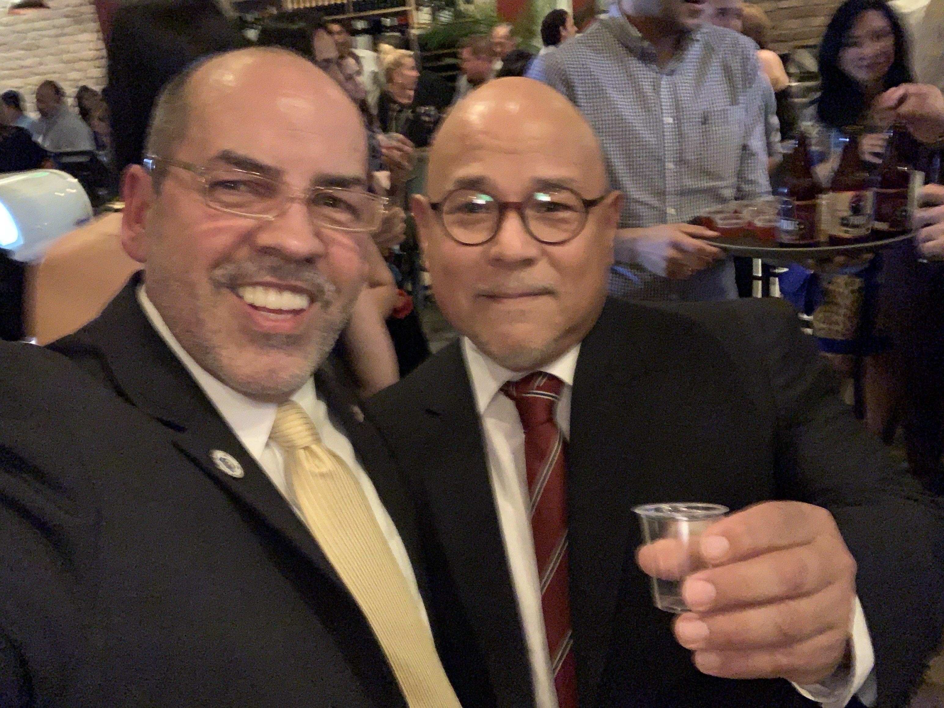 Manny Sarmiento taking a photo with member at El Gran Inka Grand Opening.