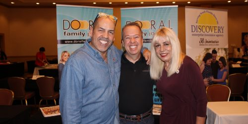Manny Sarmiento, Carmen Lopez, with a member in ExpoMiami 2018 hosted by the Doral Chamber of Commerce.