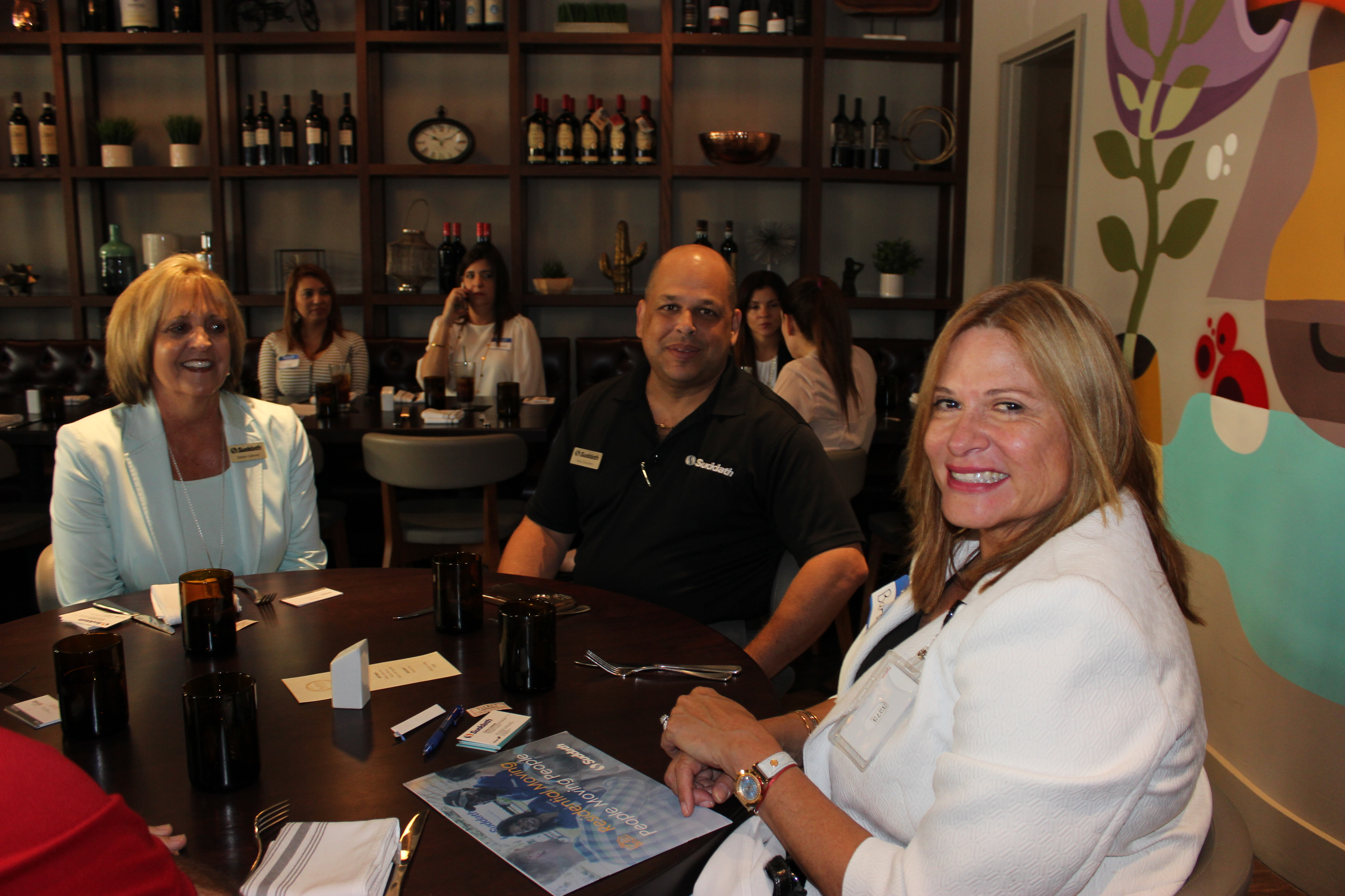 Group picture in table at Gusto Ristobar Luncheon hosted by the Doral Chamber of Commerce.