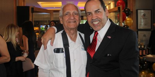Manny Sarmiento with his father at Mirador Apartments Grand Opening.