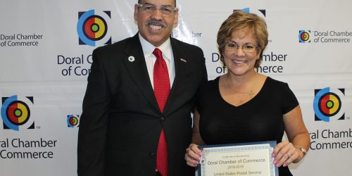 Doral Chamber of Commerce introduces Circle of Success event, photo with Manny Sarmiento, member being given an award.