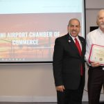 Doral Chamber of Commerce introduces Circle of Success event, photo with Miami Airport Chamber of Commerce background and with Sergio's owner.