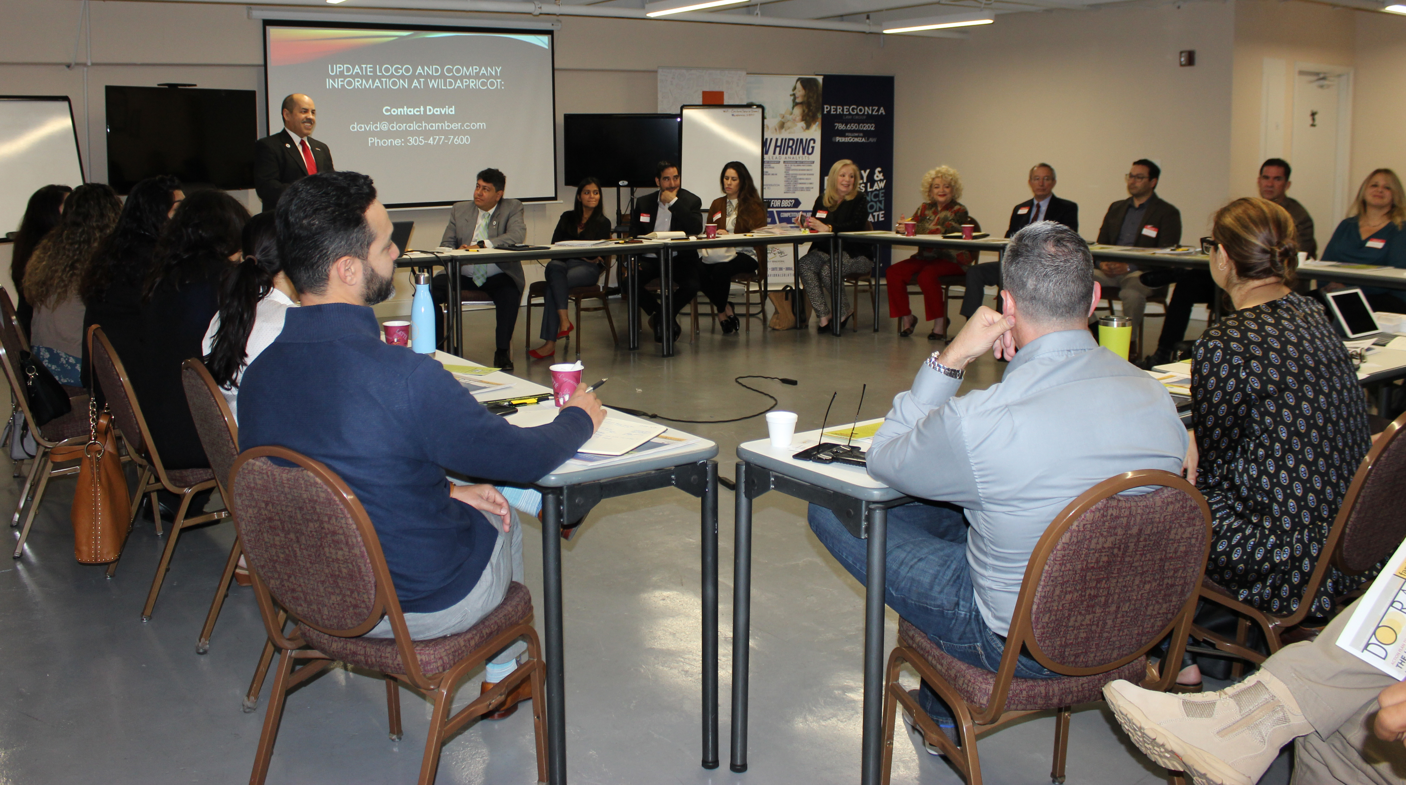 Doral Chamber of Commerce introduces Circle of Success event, everyone meeting and listening.