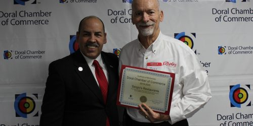 Doral Chamber of Commerce introduces Circle of Success event, Sergios owner being given an award by Manny Sarmiento.