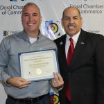 Doral Chamber of Commerce introduces Circle of Success event, member from 1st Financial being awarded by Manny Sarmiento.