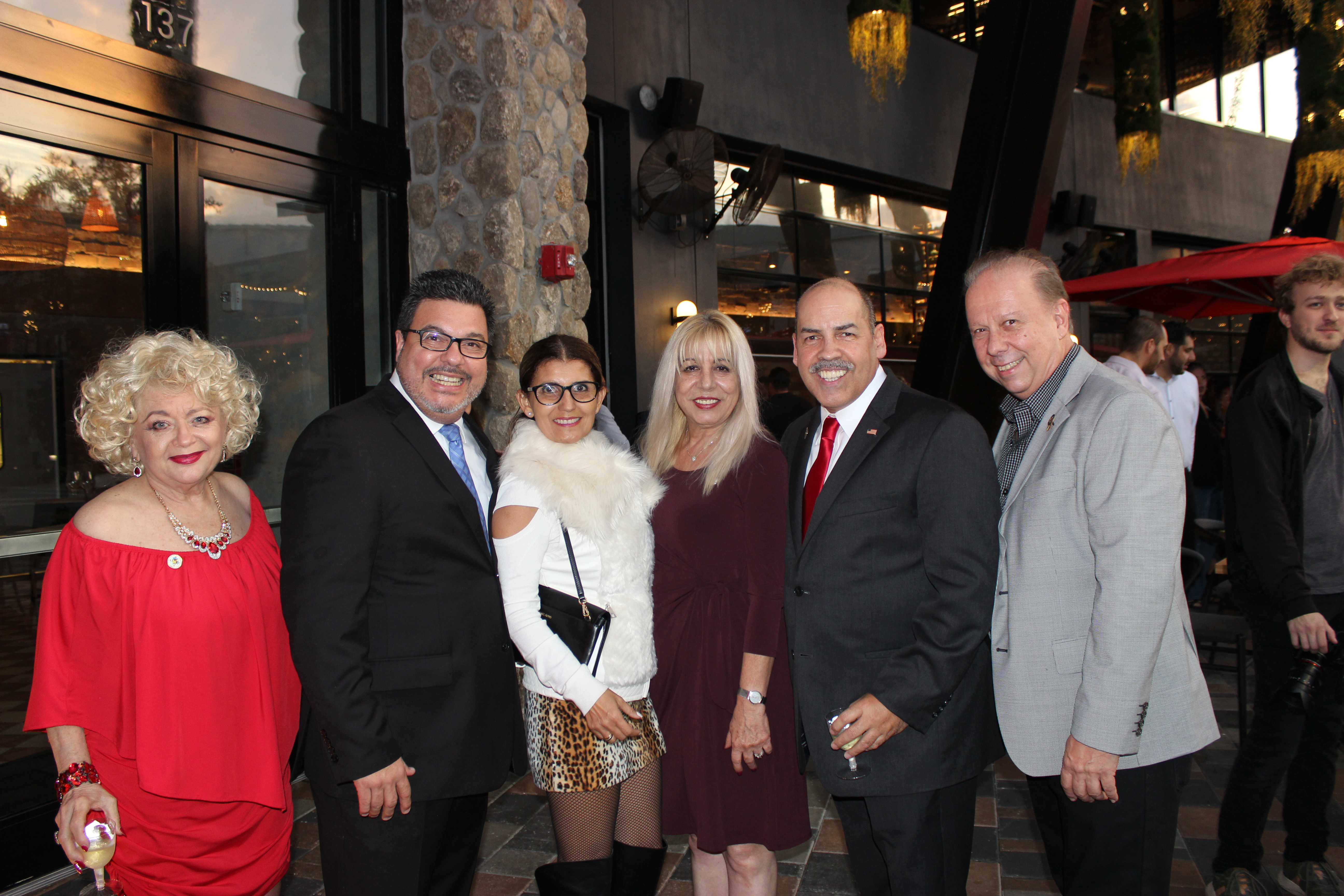 Doral Chamber of Commerce introduces Novecento Grand Opening, group photo with Manny Sarmiento, Carmen Lopez, and Blache de Jesus.