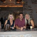 Doral Chamber of Commerce introduces Novecento Grand Opening Event, group photo with 2 ladies.