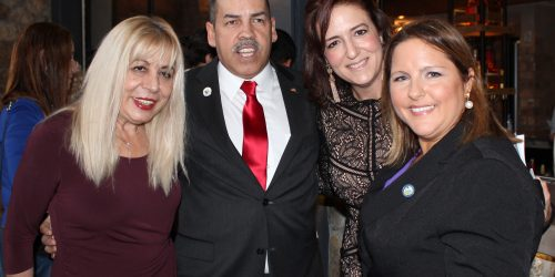 Doral Chamber of Commerce introduces Novecento Grand Opening, group photo with Manny Sarmiento and Carmen Lopez.