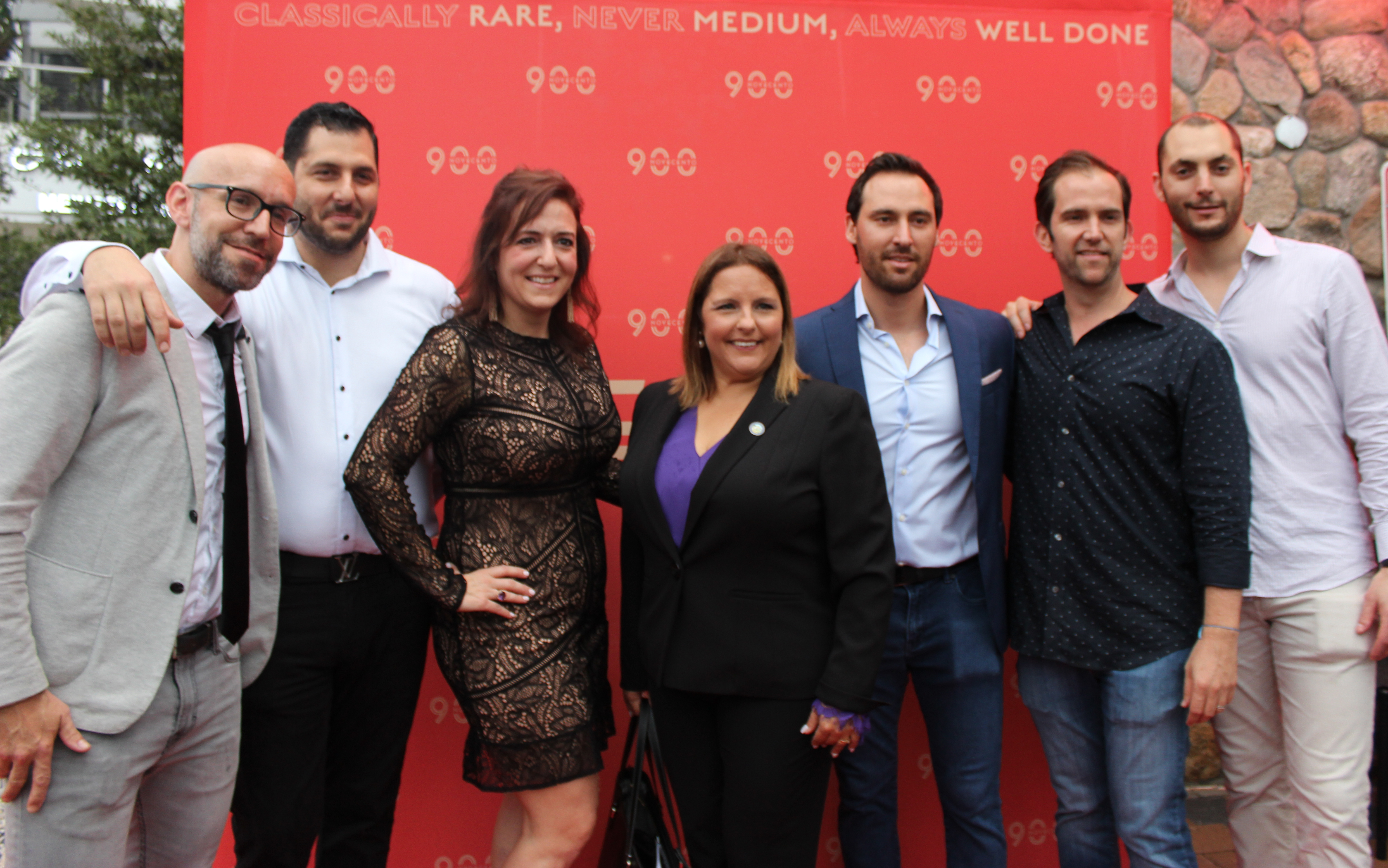 Doral Chamber of Commerce introduces Novecento Grand Opening, group photo outside.