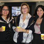 Doral Chamber of Commerce introduces DCC 21st Century Technology event, ladies taking a group photo together.