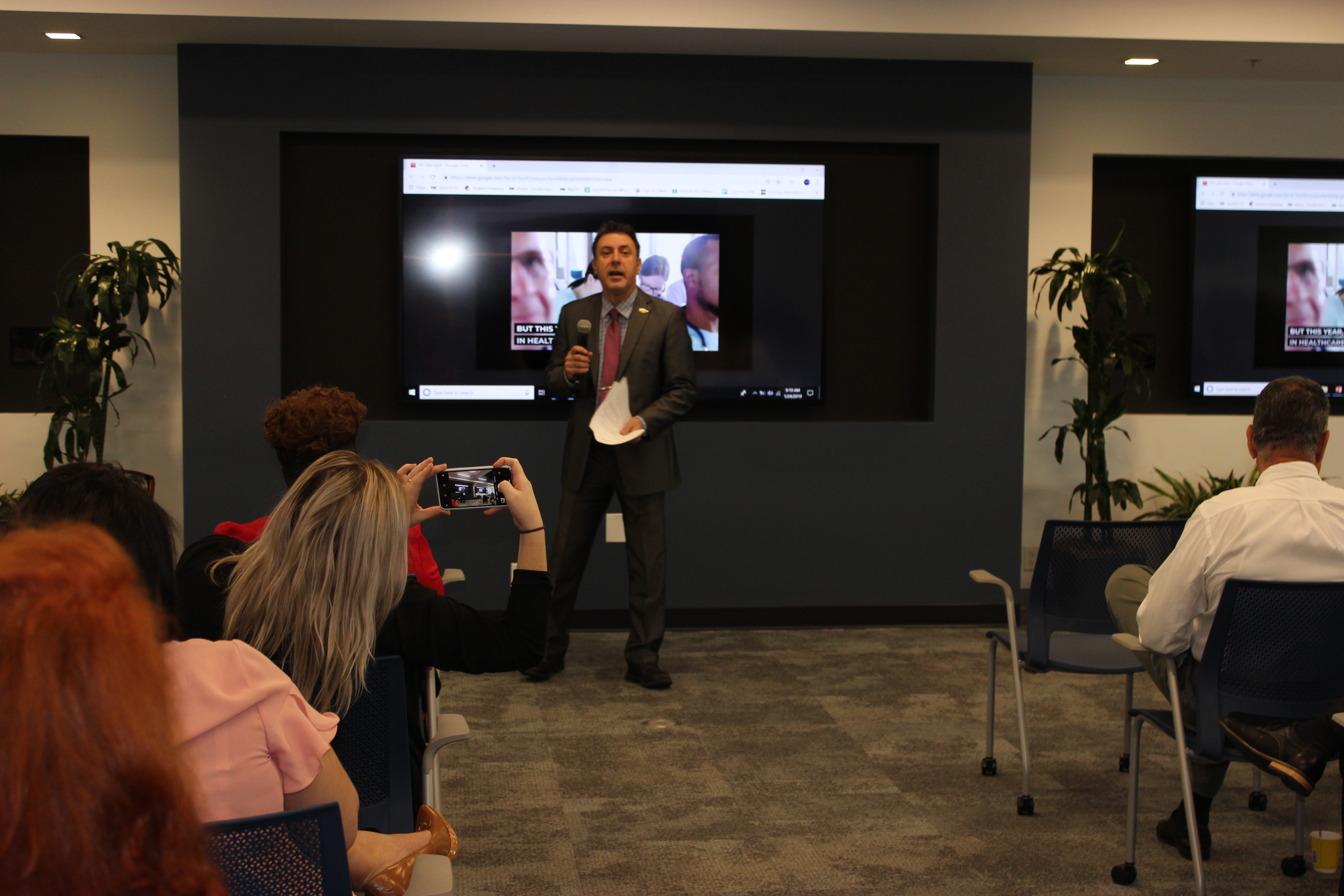 Doral Chamber of Commerce introduces DCC 21st Century Technology event, host talking to people about the newest technology.