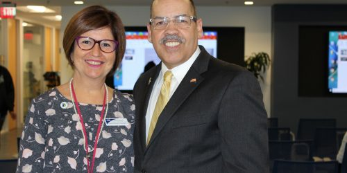 Doral Chamber of Commerce introduces DCC 21st Century Technology event, woman taking a photo with Manny Sarmiento.