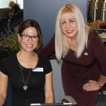 Doral Chamber of Commerce introduces DCC 21st Century Technology event, woman taking a photo with Carmen Lopez.