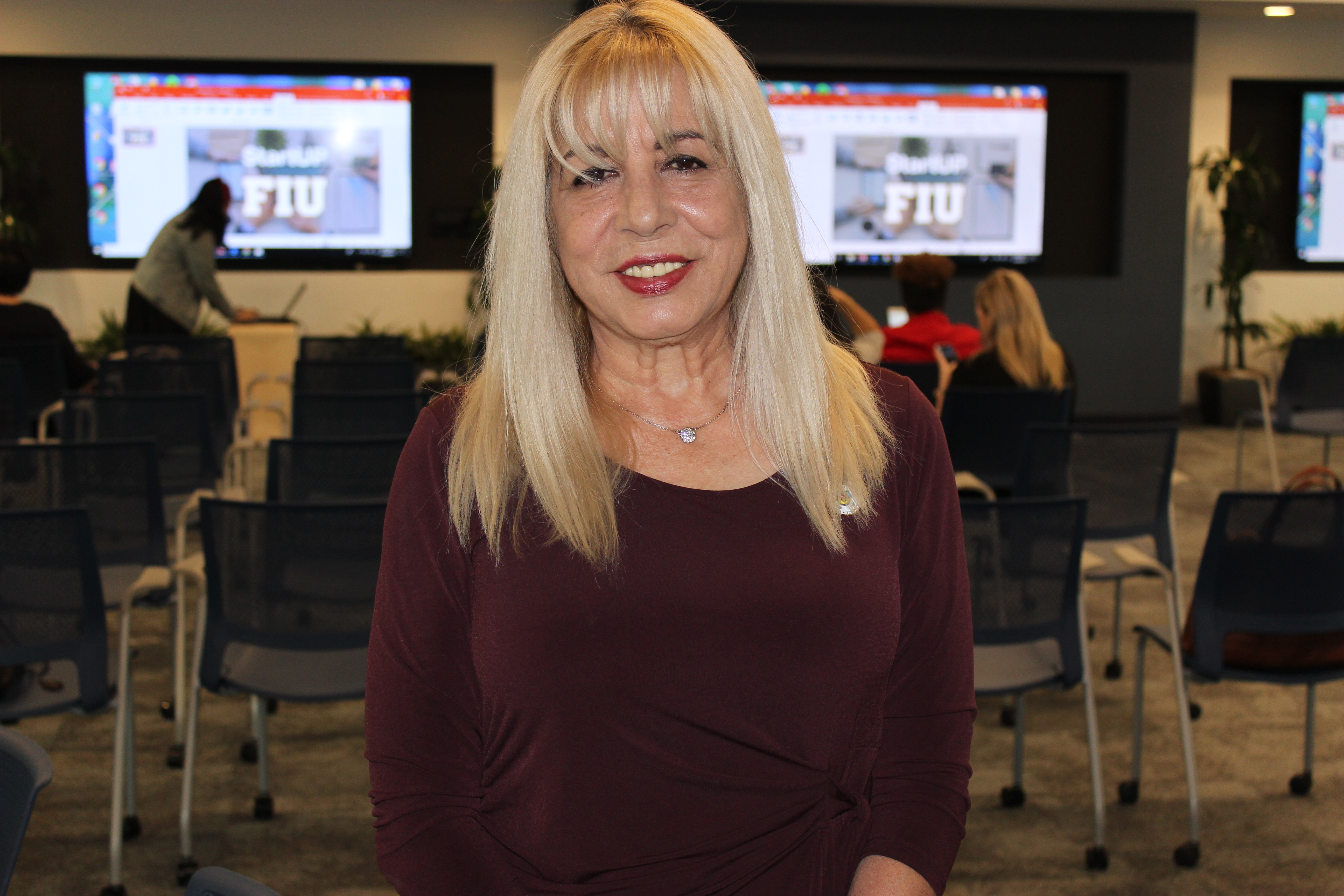 Doral Chamber of Commerce introduces DCC 21st Century Technology, Carmen Lopez taking a solo picture.
