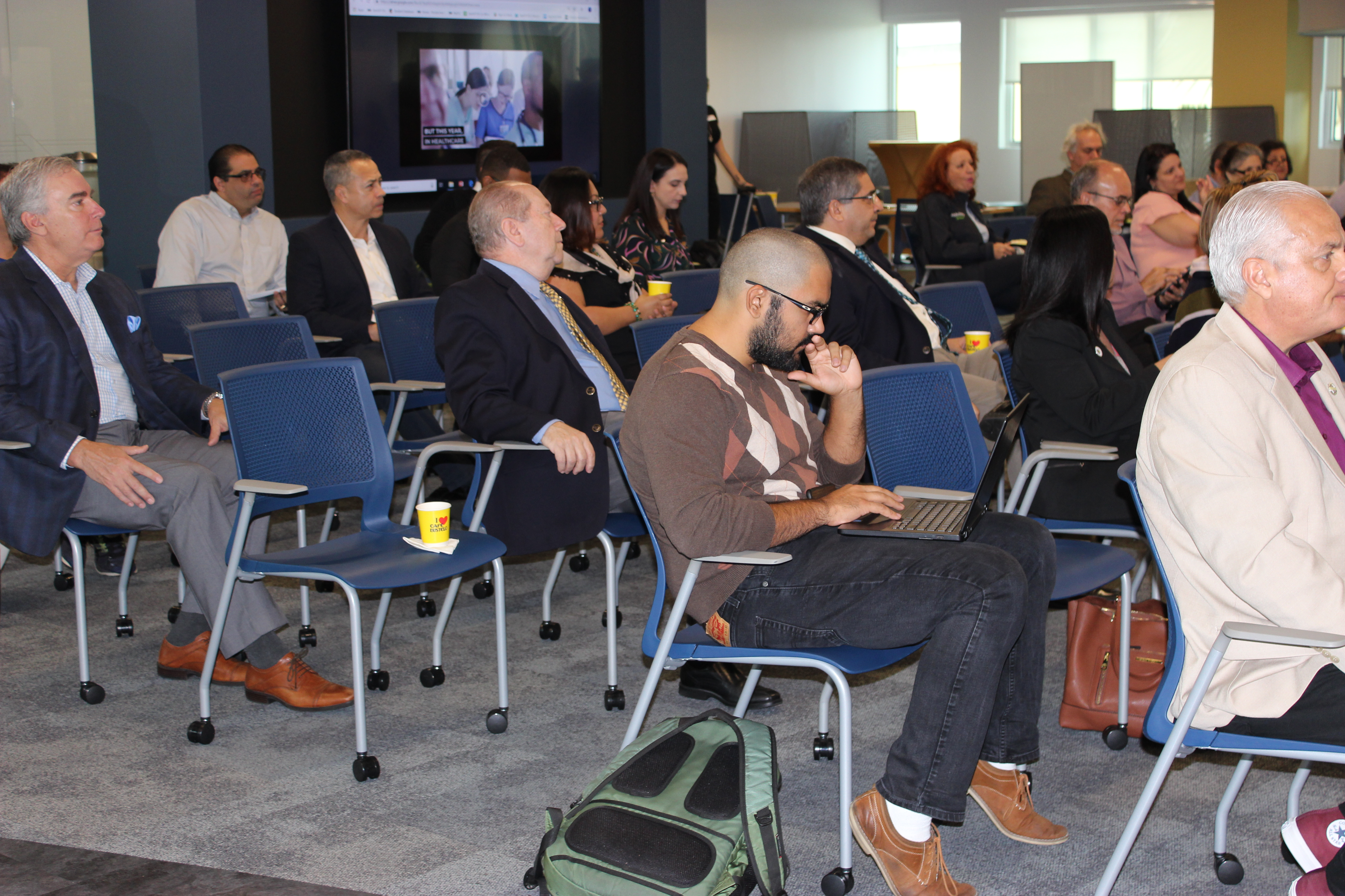 Doral Chamber of Commerce introduces DCC 21st Century Technology event, members listening in on the newest technology.