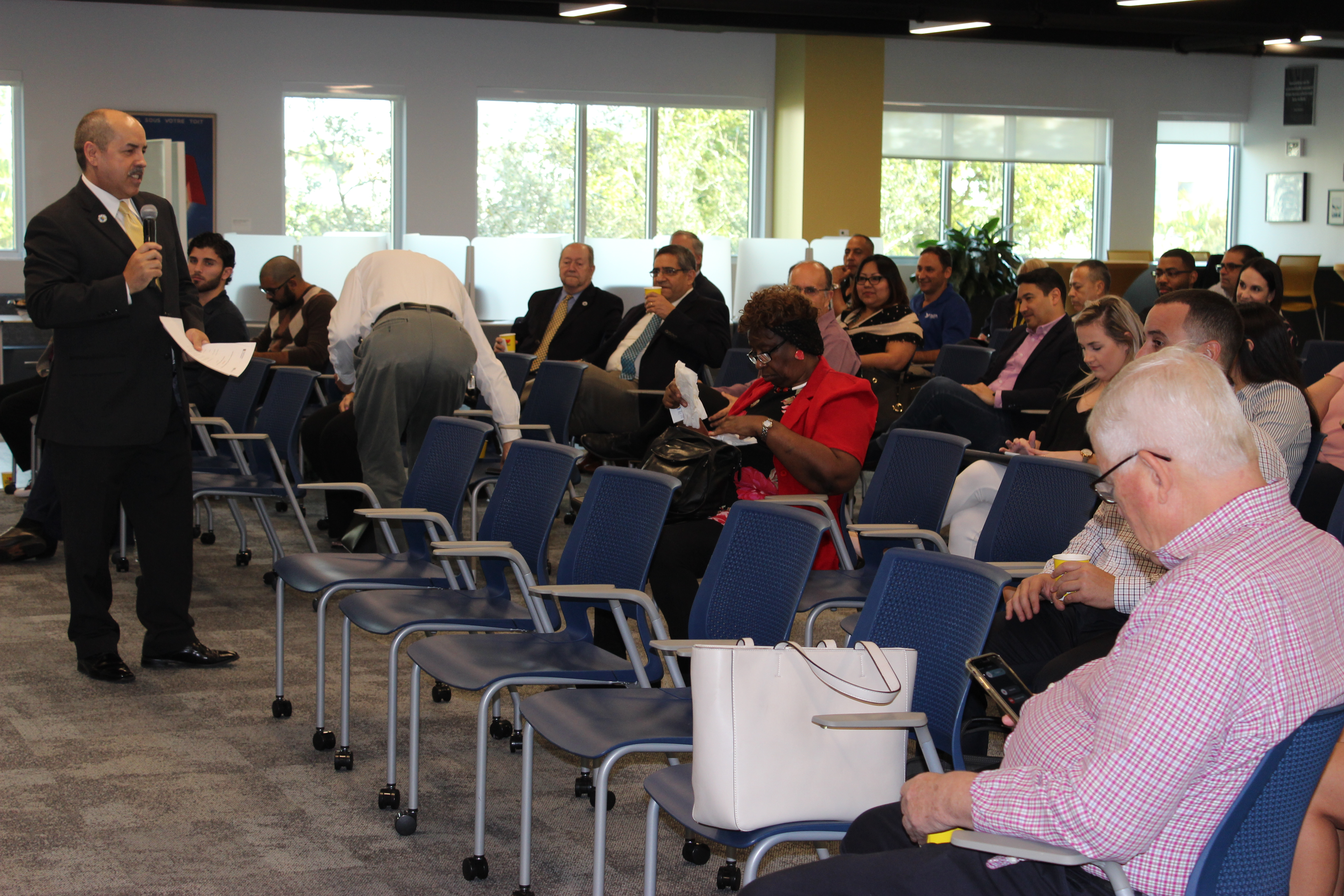 Doral Chamber of Commerce introduces DCC 21st Century Technology event, members settling and learning more from Manny Sarmiento.