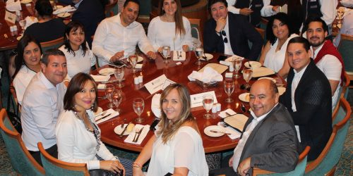 Doral Chamber of Commerce Carnival Cruise Luncheon 2019, Networking Event in Miami, Florida. Entire table taking a group photo.