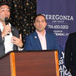 Doral Chamber of Commerce Carnival Cruise Luncheon 2019, Networking Event in Miami, Florida. PereGonza Law Group talking on stage, Robert Gonzalez.