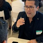 Doral Chamber of Commerce IKEA Speed Networking Event, DCC Member explaining about his company while taking notes.