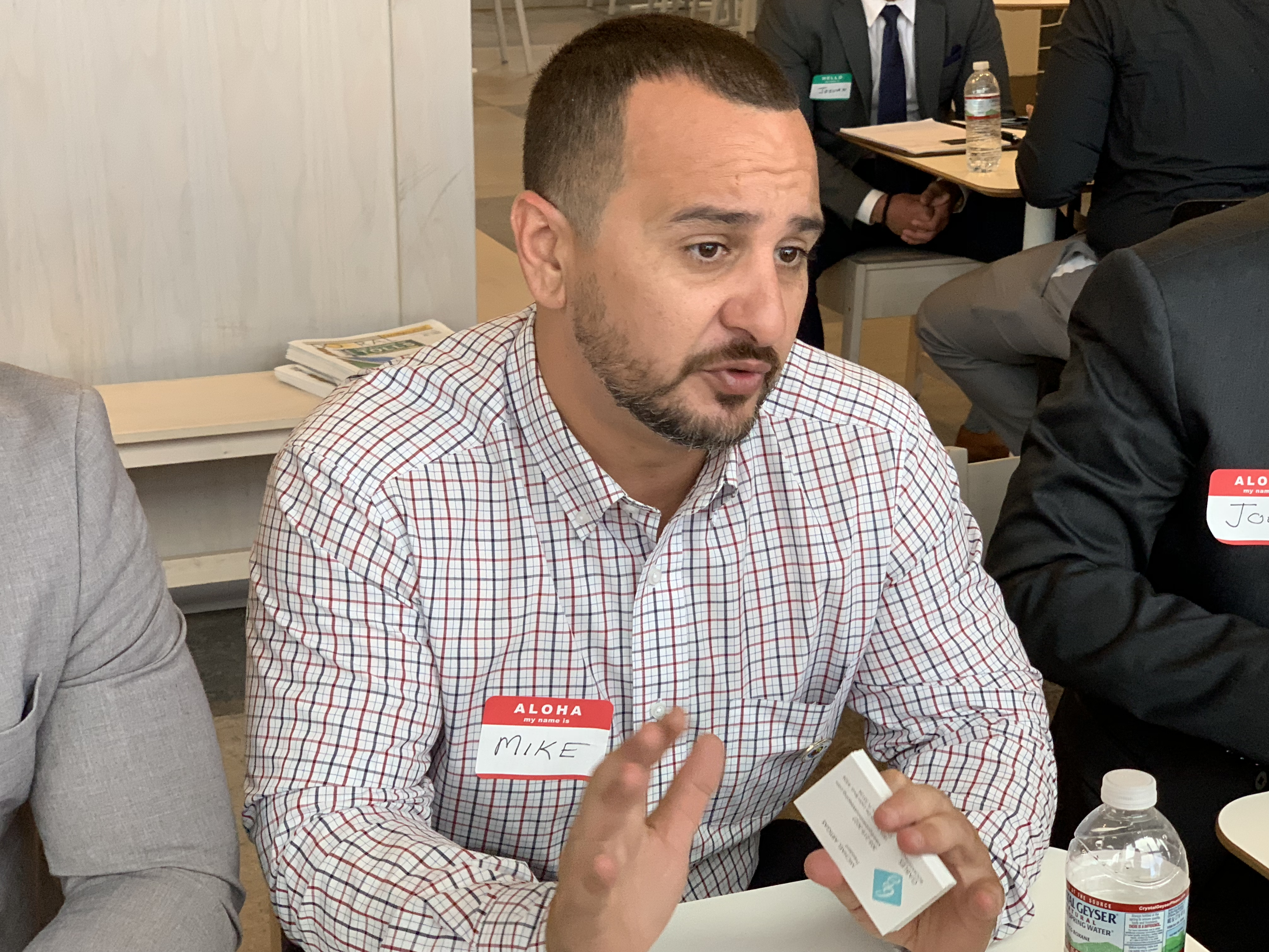 Doral Chamber of Commerce IKEA Speed Networking Event, member talking about his business before he passes his business card, creating a relationship.