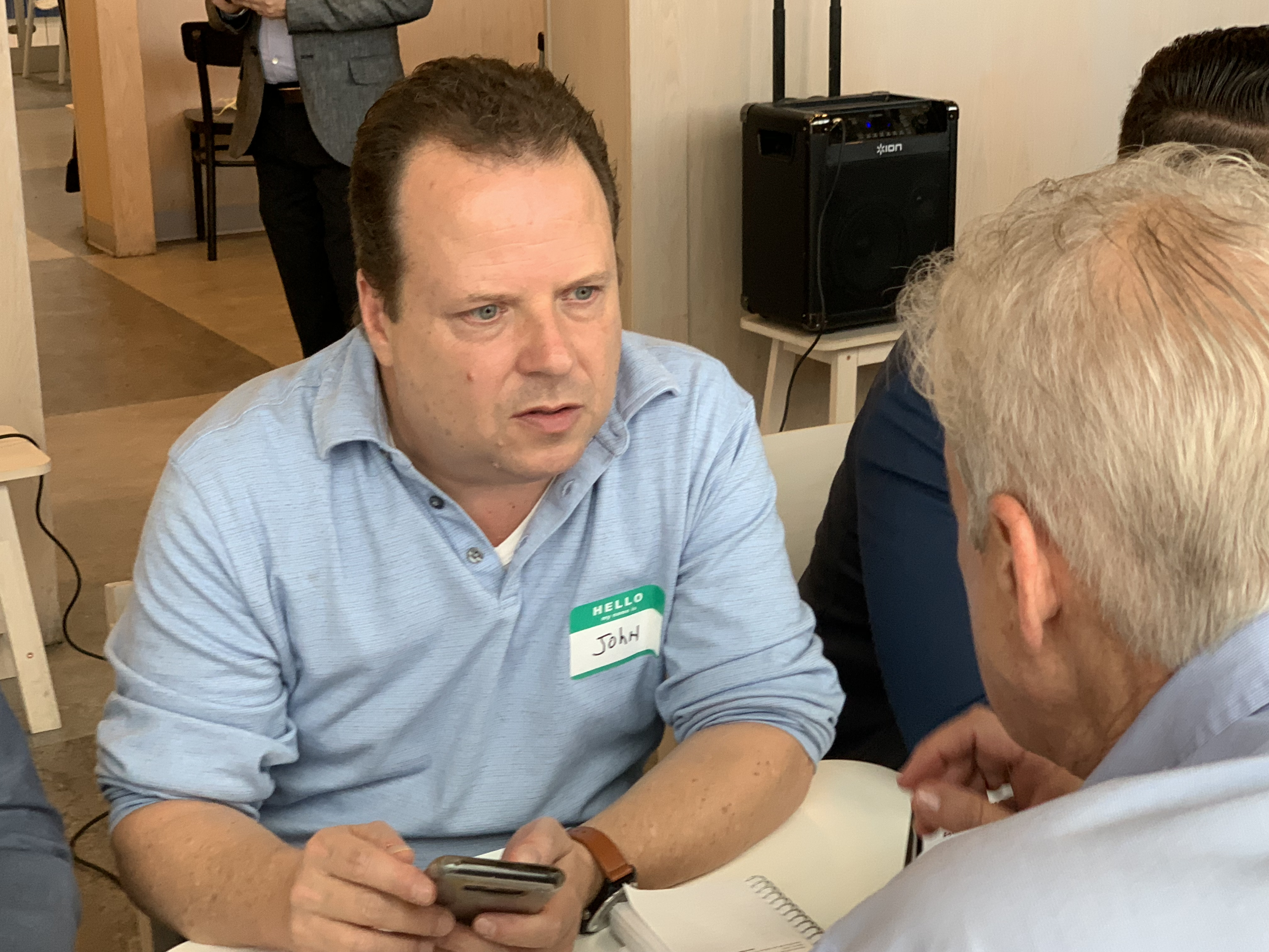 Doral Chamber of Commerce IKEA Speed Networking Event, member writing down phone number and taking notes.