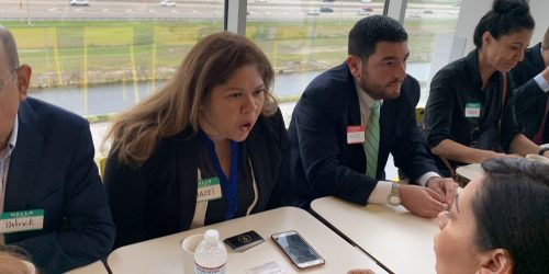 Doral Chamber of Commerce IKEA Speed Networking Event, member discussing business with another at the event.