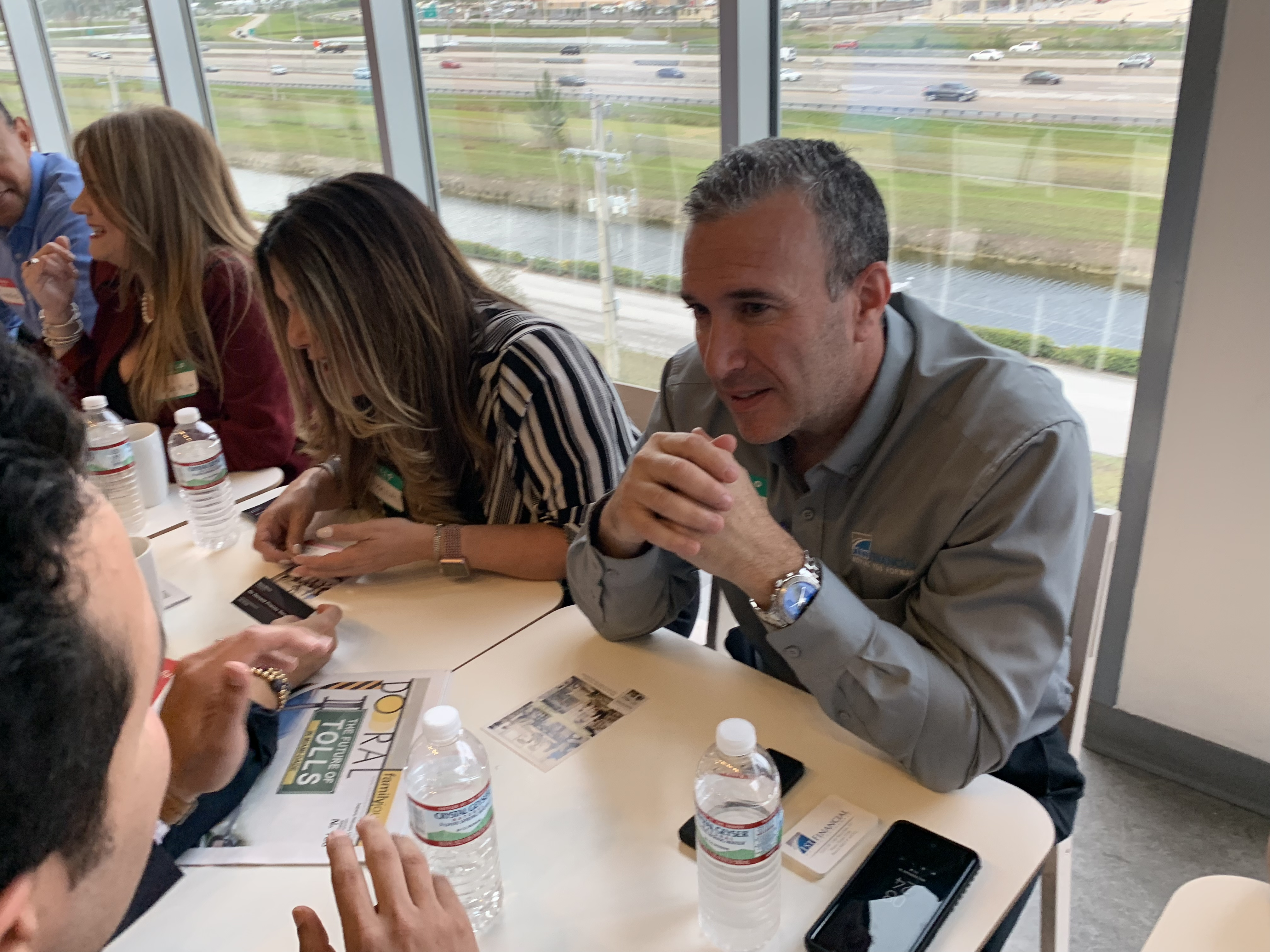 Doral Chamber of Commerce IKEA Speed Networking Event, DCC member listening to another member talk about their business.