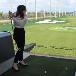 Doral Chamber of Commerce introduces a golfer making points at Topgolf Doral Networking Luncheon Event.