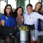 Doral Chamber of Commerce introduces a group photo of many members at Topgolf Doral Networking Luncheon Event.