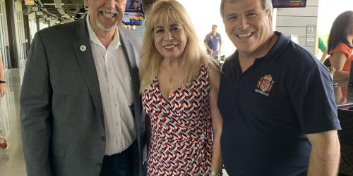 Doral Chamber of Commerce introduces Carmen Lopez taking a photo with two members at Topgolf Doral Networking Luncheon Event.