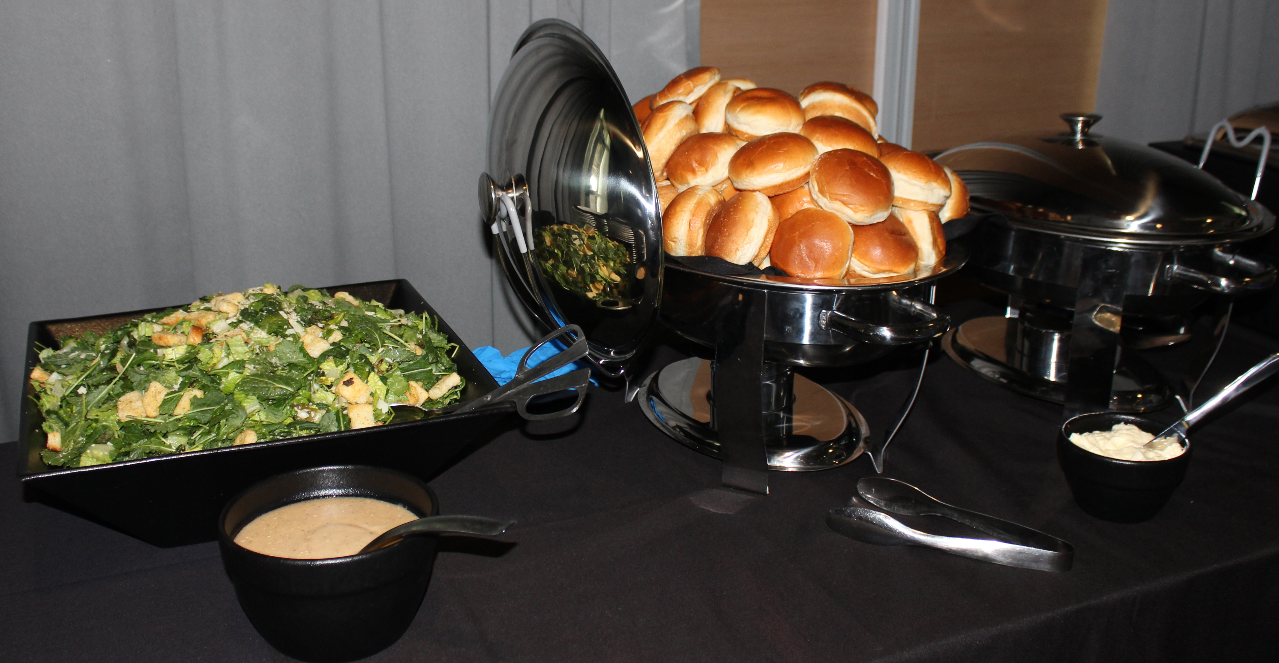 Doral Chamber of Commerce introduces bread and salad with dressing at Topgolf Doral Luncheon Networking Event.