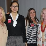 Doral Chamber of Commerce introduces a group of female members taking a photo together at Topgolf Doral Networking Luncheon Event.