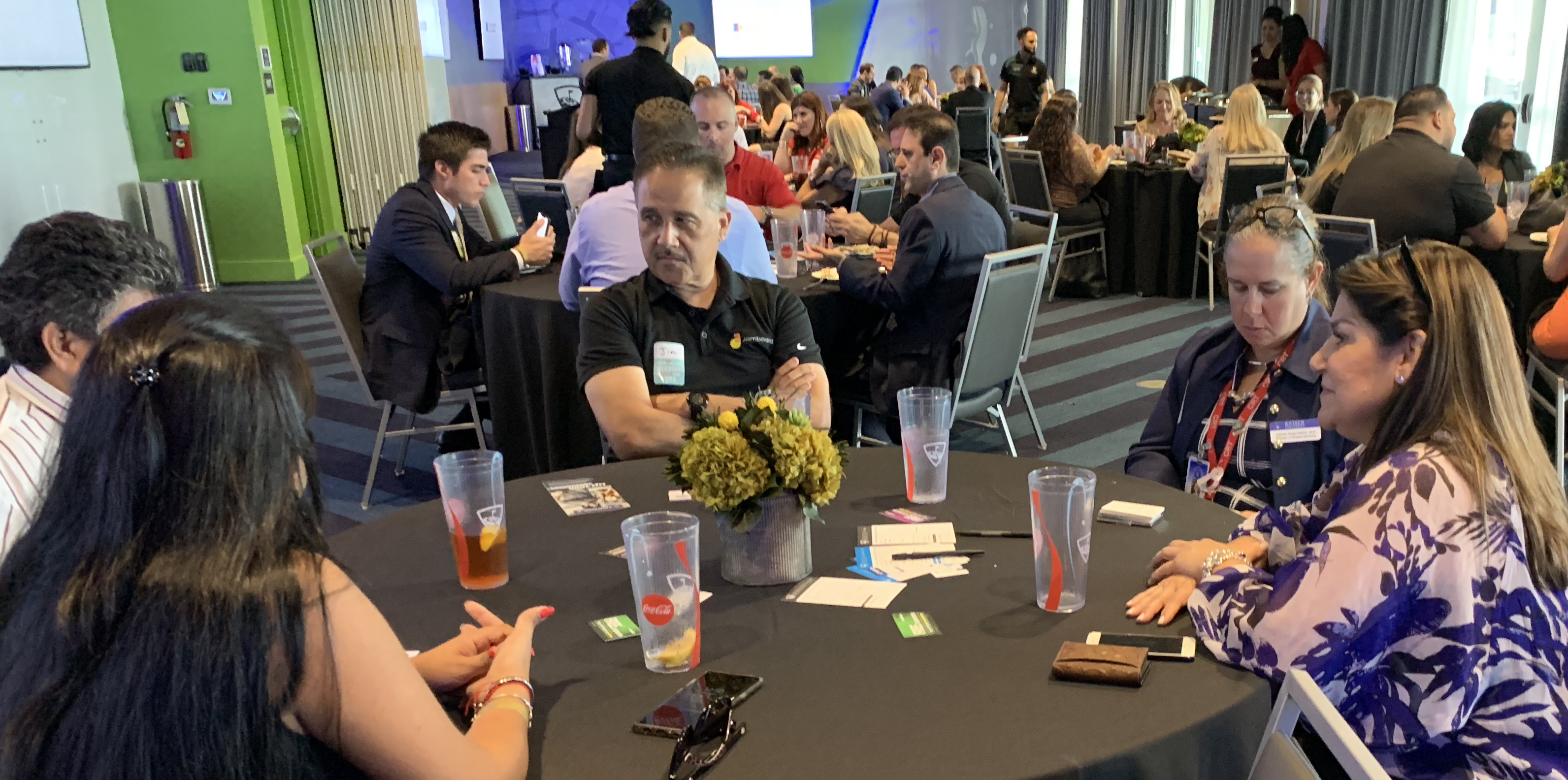 Doral Chamber of Commerce introduces members networking in a table at Topgolf Doral.