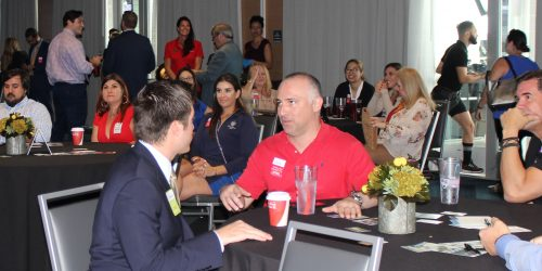 Doral Chamber of Commerce introduces members networking and talking at Topgolf Doral Networking Luncheon Event.