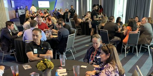 Doral Chamber of Commerce introduces members networking and being served drinks at Topgolf Doral.