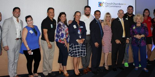 Doral Chamber of Commerce introduces a group photo of many members including Topgolf Manager at the Networking event.