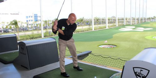 Doral Chamber of Commerce introduces a member playing golf, enjoying himself, and networking at Topgolf Doral Luncheon.